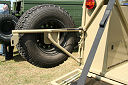Swing away spare wheel holder