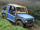 Blue and yellow Suzuki based off road vehicle