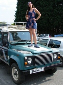 Hippy chick standing on bonnet